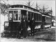 Motorman and Conductor with early Capital Traction streetcar pair.