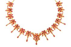 A necklace crafted in gold set with rubies