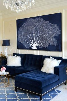 Coral Fan Cyanotype Canvas Wall Art with crown mouldings, gilded side tables, and a jaw-droppingly luxe navy blue tufted velvet sectional!