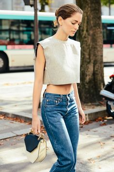 Oui, Oui! High waisted Levi's, paired with a sleek crop top. Shot by Tommy Ton photography during Paris Fashion Week for Spring 2015.