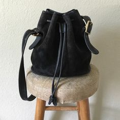 Vintage coach bucket bag Vintage coach drawstring suede leather bucket bag in great condition. The only visible flaw is the red mark on the inside flap shown in the last picture. The strap is adjustable. Coach Bags Crossbody Bags