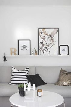 Simple patterns, mixed with a touch of gold and black, give this room a modern, yet feminine feel.