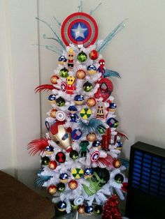 19 Most Creative Kids Christmas Trees. Avengers Inspired Tree Idea featured on Pretty My Party.