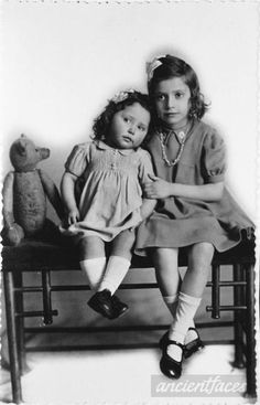 A photo of Adele Nitka who was born in Paris, France in 1933, and Paulette who was born also in Paris, France in 1940: two sisters with a teddy bear. Both of them were murdered in Auschwitz in 1942 at age 9 and 2 years.