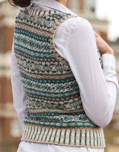 Enjoy colorwork knitting patterns for a vest, sweater, mitts, bag, box, and scarf, all when you download your free eBook!