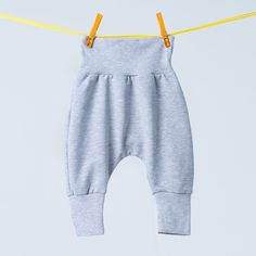 Baby sweatpants  with gray pullers.  Ideal for babies and older children. Loose fit of pants and applying high-pullers at the waist and ankles make the pants fit perfectly to the children's...
