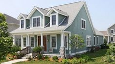 A cape cod house with a front porch