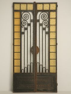 Vintage French Art Deco cast iron and glass doors.