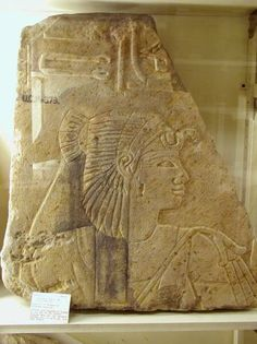 Sandstone slab with head of Princess Sitamen, daughter of King Amenhotep III in relief with Mut headdress, and above part of her cartouche. Petrie Museum, London.