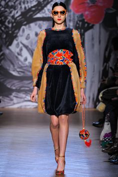 FALL 2013 READY-TO-WEAR  Tsumori Chisato /   Do lobsters feel pain? What happens when we die? Is one polka dot a polka dot, or is it just a circle? These are a few of the philosophical questions raised by Tsumori Chisato's typically eclectic, but unusually chic, new collection. The fact that this collection made heavy use of a lobster motif—part of a larger marine reference—was par for the rather surreal Chisato course.