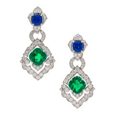 An Important Pair of Platinum, Emerald, Sapphire and Diamond earrings.