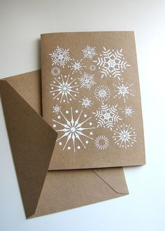 Using brown paper as your background ensures your stylish white snow scene stands out.