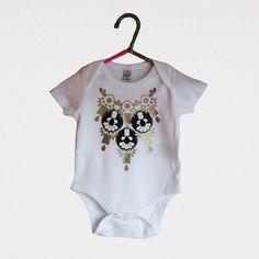 custom babygrow, embellished with a gold vinyl print, appliqué panels and soft vinyl jewels.  dakotaraedust