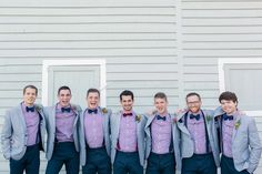 Andrew and his groomsmen wore navy slacks, gray blazers, and red and navy checkered dress shirts. Andrew wore a red bow tie while his groomsmen wore matching navy bow ties. Navy Bow Tie, Bow Ties, Groomsmen Colours, Wedding Styles, Wedding Photos, Lavender Shirt, Bow Tie Wedding, Bridesmaids And Groomsmen, Red Shirt