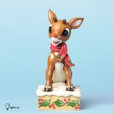 Jim Shore for Enesco Rudolph Traditions with Blinking Nose Figurine 394Inch *** Be sure to check out this awesome product.