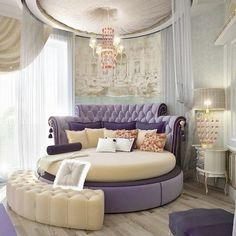 Royal Suite ~ round purple & cream bed, cream padded ceiling, cream crescent bench gives room a regal feeling. Fit for a Queen.