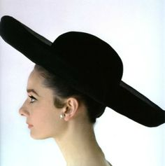 The actress Audrey Hepburn photographed by Howell Conant at her house in Bürgenstock (Switzerland), in February 1962. Audrey was wearing: Hat: Givenchy (lined with a kind of organza starched, black, of his collection for the Spring of 1962). Notes: The Audrey's hairstyle was done by Alexandre de Paris and her makeup by Alberto de Rossi.