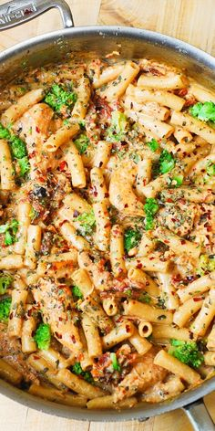 Chicken and Broccoli Pasta with Sun-Dried Tomato Cream Sauce: short, penne pasta smothered in a flavorful, creamy sauce spiced up with garlic, sun-dried tomatoes, basil and crushed red pepper flakes! A taste of Italy! JuliasAlbum.com #pasta #dinner #recipe