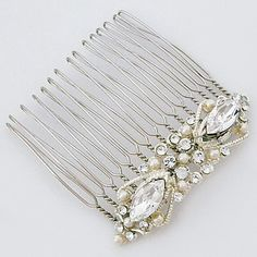 Cheryl King Couture Bridal Hair Accessories. Delicate vintage bridal hair comb with large marquis crystals set on a filigree design joined by pearls & crystals.