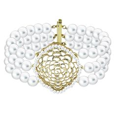6.5-7mm Akoya pearls. The bracelet has been intricately crafted in 14k gold and features shimmering diamonds as well as precious seed pearls embellishing the centerpiece creating the look of vintage elegance.