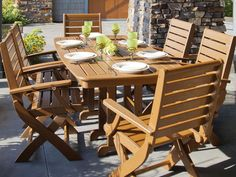 Signature 7-Piece Dining Set. Features six folding chairs and a roomy rectangle table. Outdoor dining furniture made from recycled plastic.