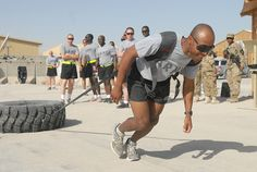 Sgt. 1st Class Phillip Preyer of Company C, 702nd Brigade Support Battalion, 4th Brigade Combat Team, 2nd Infantry Division, races for the finish in the tire pull event at the battalion's Mid-Tour Celebration March 17 at Kandahar Airfield, Afghanistan.