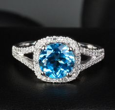 Natural 7.5mm Blue Topaz and Diamond Halo Engagement by TheLOGR