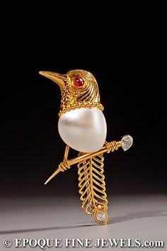 CARTIER An amusing 18 karat gold and gem set bird brooch, designed as a bird on…