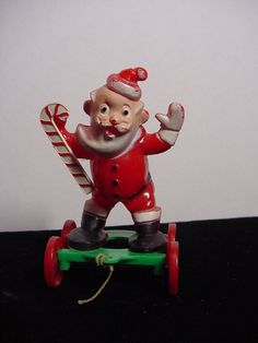 Vintage Christmas Plastic SANTA pull toy CANDY CONTAINER Rosbro Rosen on wheels