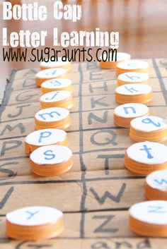 By The Sugar Aunts: Use Bottle Caps for letter learning. Match upper/lower case letters, practice letter direction, match letter sounds to real life objects.  Or, put them in a sensory bin for fun letter play!