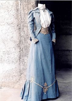 Circa 1890, blue cotton walking suit. Jacket and skirt with detail of Venetian point lace and glass beads. #victorian