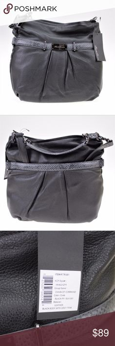 """Kenneth Cole New York Chain of Command Black Hobo This soft leather hobo is features sleek pewter-toned hardware and a bold chain detail at the handle. Genuine leather material Detachable shoulder strap Top-zip closure Magnetic back pocket Lined interior features two patch pockets and a zipped pocket Kenneth Cole nameplate accents the front Measurements approx.: 8"""" Handle drop. 13.5"""" Height, 15"""" length, 2"""" depth Kenneth Cole Bags Hobos"""
