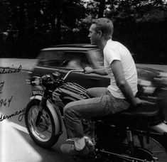 Steve McQueen, riding his Triumph in Clark's desert boots, Levis and white Fruit-​​Of-​​The-​​Loom.