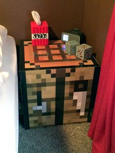 Minecraft crafting table, TNT klenex box and lighted diamond and redstone ore for the nightstand.
