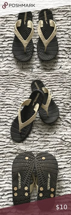 Speedo Gray /cream flip flops size 9 Treat yourself to a great pair of flip flops size Shipped with USPS priority Mail Speedo Shoes Sandals Priority Mail, Women's Shoes Sandals, Gray Color, Pairs, Best Deals, Grey, Closet, Things To Sell, Armoire