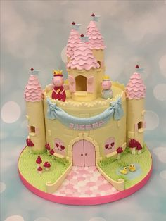 Peppa pig castle birthday cake and cupcakes