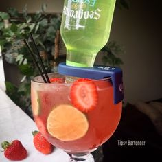 Tipsy Bartender Strawberry Lime Megarita- strawberry rum, strawberry nectar, triple sec, strawberry and lime slices, seagrams escapes classic lime margarita