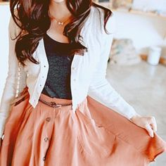 Salmon skirt, black shirt, white blazer. gold bow necklace.