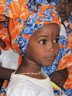 Child in traditional headdress in Senegal