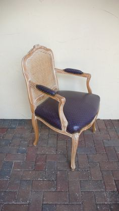 Vintage Cane Back French Louis Arm Chair Wood frame - Shown with original Shabby Chic Blue Vinyl Fabric - can be ANY FABRIC. $349.00, via Etsy.