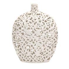 Openwork ceramic vase.  Product: VaseConstruction Material: CeramicColor: WhiteFeature...