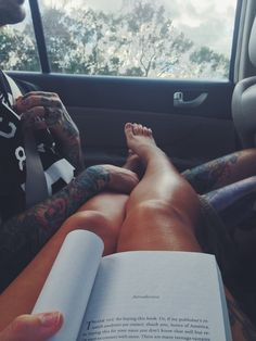"""I love a man covered in tattoos! This is just how hubs & I lounge on the couch together.. My """"stinky feet"""" on his lap."""