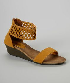 95a6cde7cecc Love this Chestnut Perforated Bororo Wedge Sandal by Bucco on  zulily!   zulilyfinds Wedge