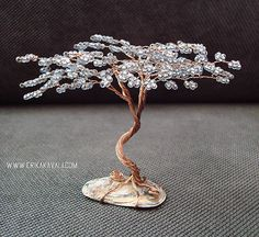 Wire tree sculpture with silver blue tone bead leaves