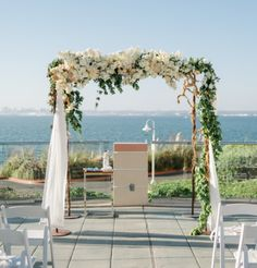 Lush Ceremony Chuppah for a  Blush & White Wedding by Isari Flower Studio