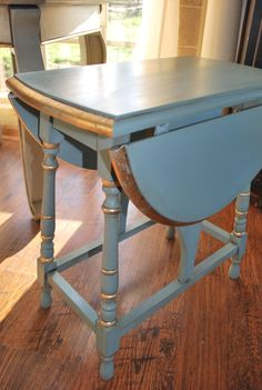 Duck Egg Blue table with a bit of gold gilding along edge. Sweet little table...sold at Three Speckled Hens