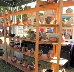ceramic artist Linda Starr makes unique contemporary pottery and sculpture with detours into cooking, travel, and gardening. Pottery Booth Display, Craft Booth Displays, Display Shelves, Shelving, Craft Booths, Display Ideas, Fairs And Festivals, Ceramic Artists, Craft Fairs