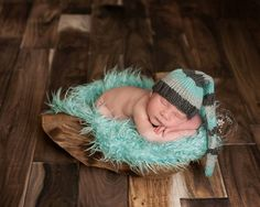 Liam Sleepy Cap is available is NEWBORN size only    Gorgeous photo by Azure Sky Imagery
