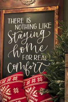 Simple farmhouse style country Christmas decorations with signage and red alpine pillows from Urban Farmgirl. #countrychristmas #farmhousechristmas #christmasdecor #holidaydecorating