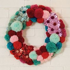 Create a wreath that is as excited about the holidays as you! This pom-pom-loving DIY wreath screams Christmas cheer: http://www.bhg.com/christmas/wreaths/pretty-christmas-wreaths/?socsrc=bhgpin120314prettypomswreath&page=25